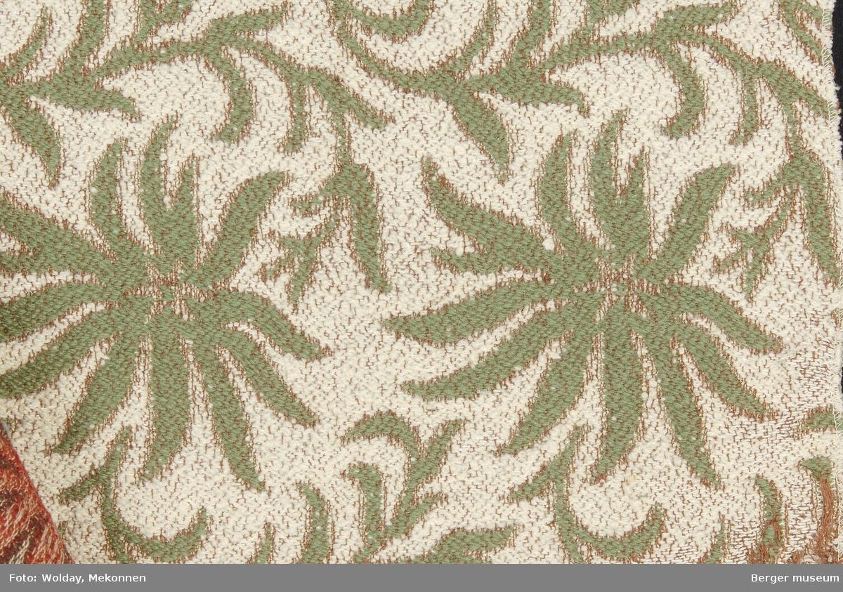 Akantus med blomst (spisse kronblader) Møbelstoff. Prøveboka har 3 prøver.