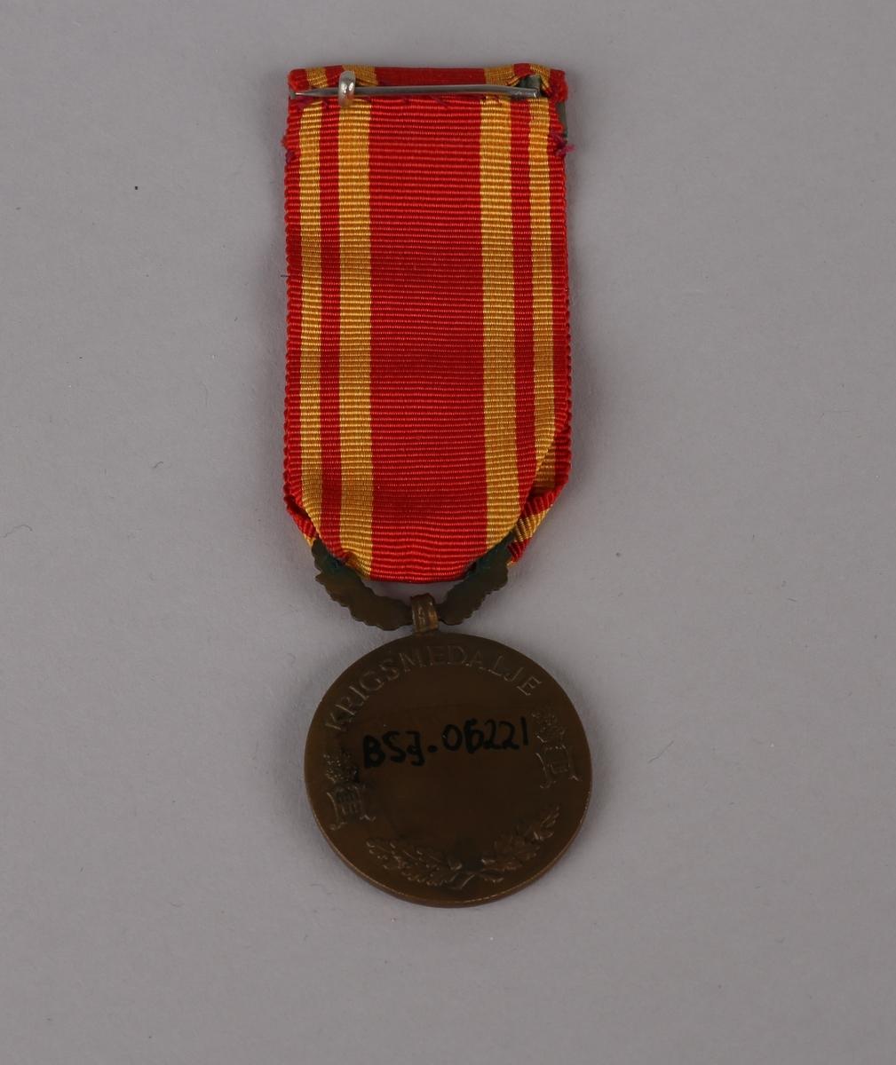 Medalje med relieff av Kong Haakon VII i profil