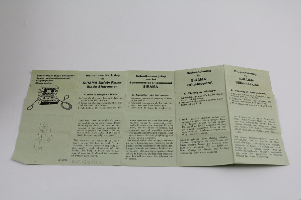 Slipemaskin i eske med bruksanvisning: a) avrundet rektangulær, åpnes på langsiden, hengslet, lang snor. b) tilhørende eske m/høye kanter og spisse hjørner. c)  trykt bruksanvisning på tynt papir, rektangulært.
