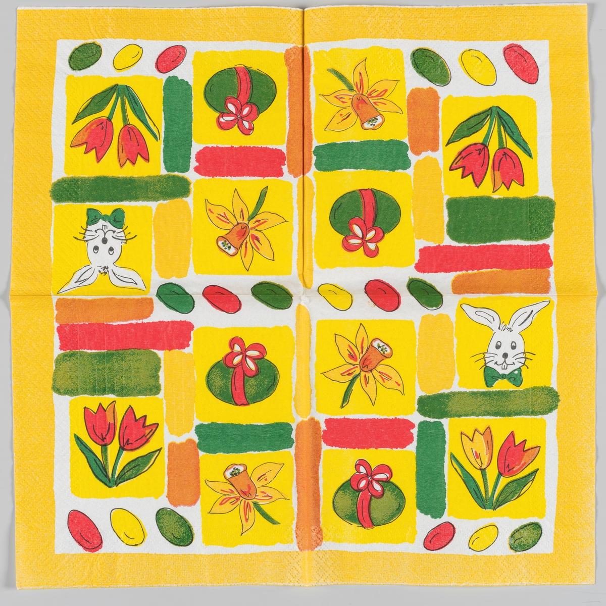 Servietten er delt inn i felter med ulike motiver. Et påskeegg med sløyfe. En kanin med sløyfe. To tulipaner. En påskelilje. Tre kulørte påskeegg. Gule, røde, oranske og grønne brede striper. Gul kant.