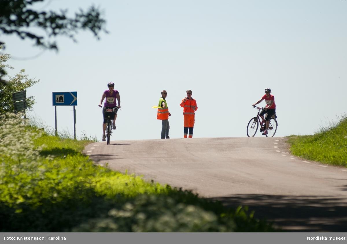 Tjejlopp- Tjejvättern 2013 Cykling utmed banan.