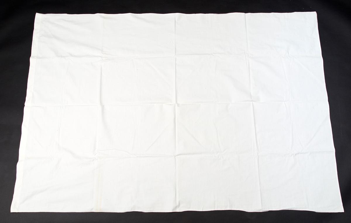 Rektangulært. En bred og en smal fall. Korssttingsbrodert hvit H i et hjørne