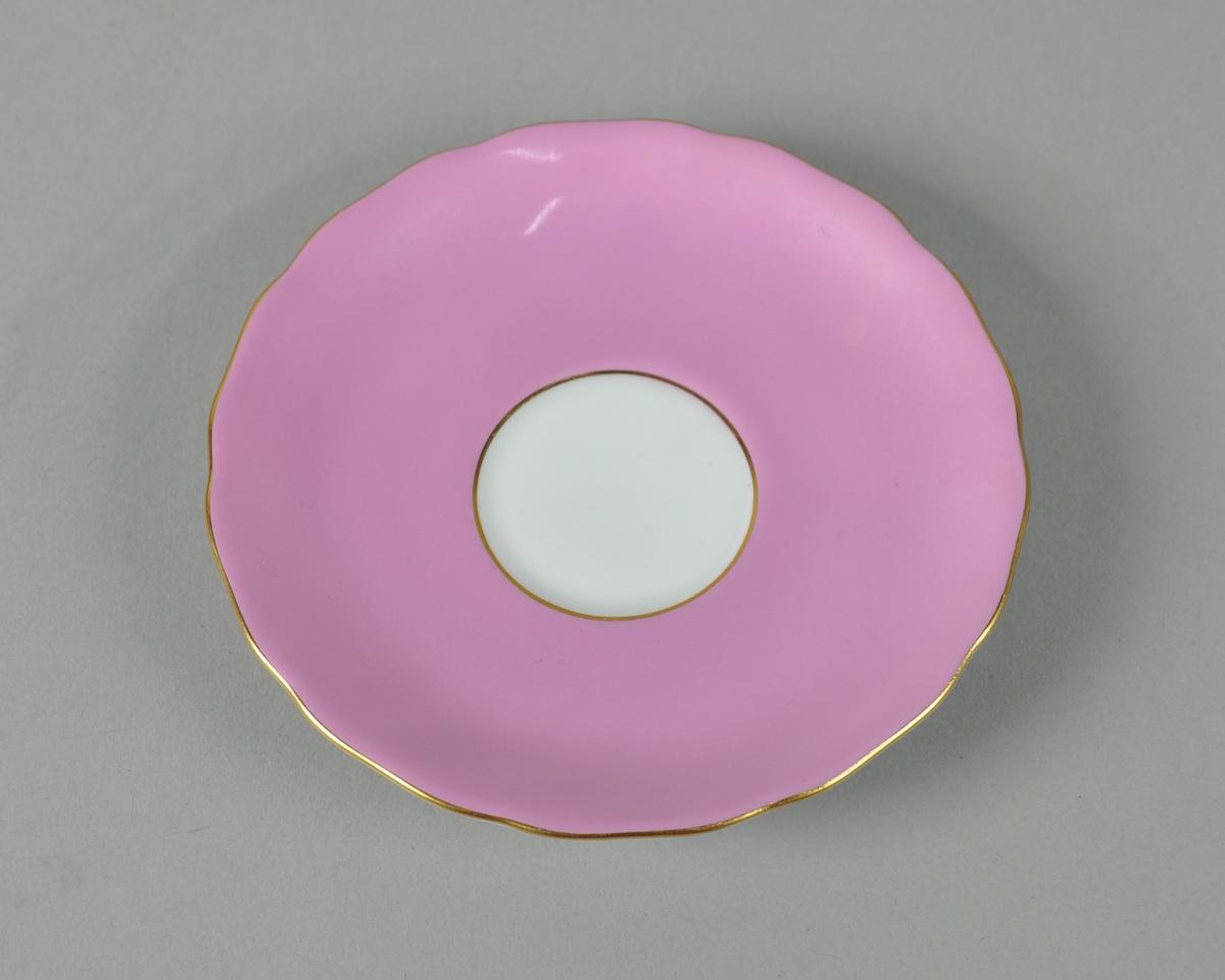 Rosa skål med gullkant.