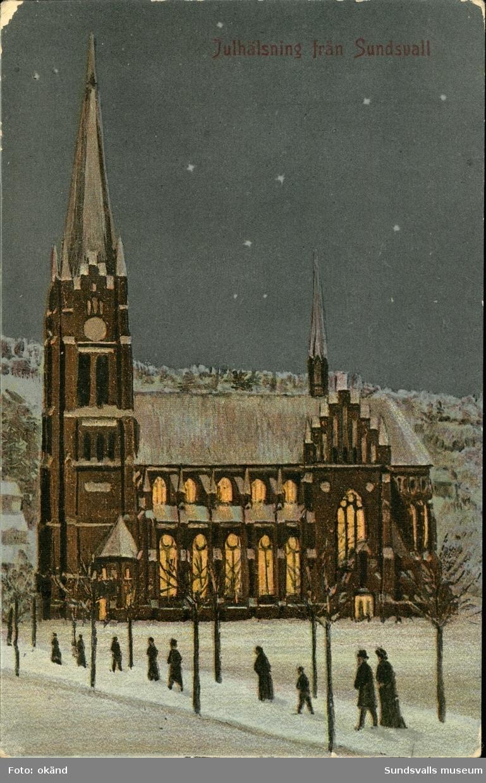 Vykort med vintermotiv över Gustav Adolfs kyrka och texten: Julhälsning från Sundsvall.