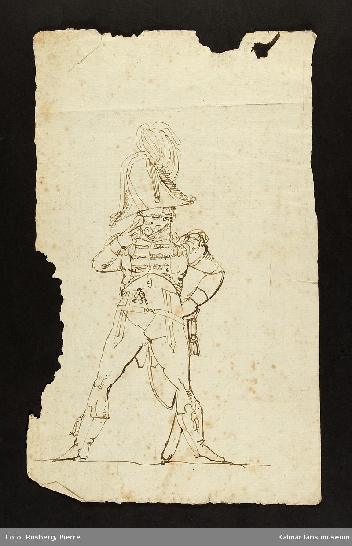 En man med uniform, samt blankvapen.