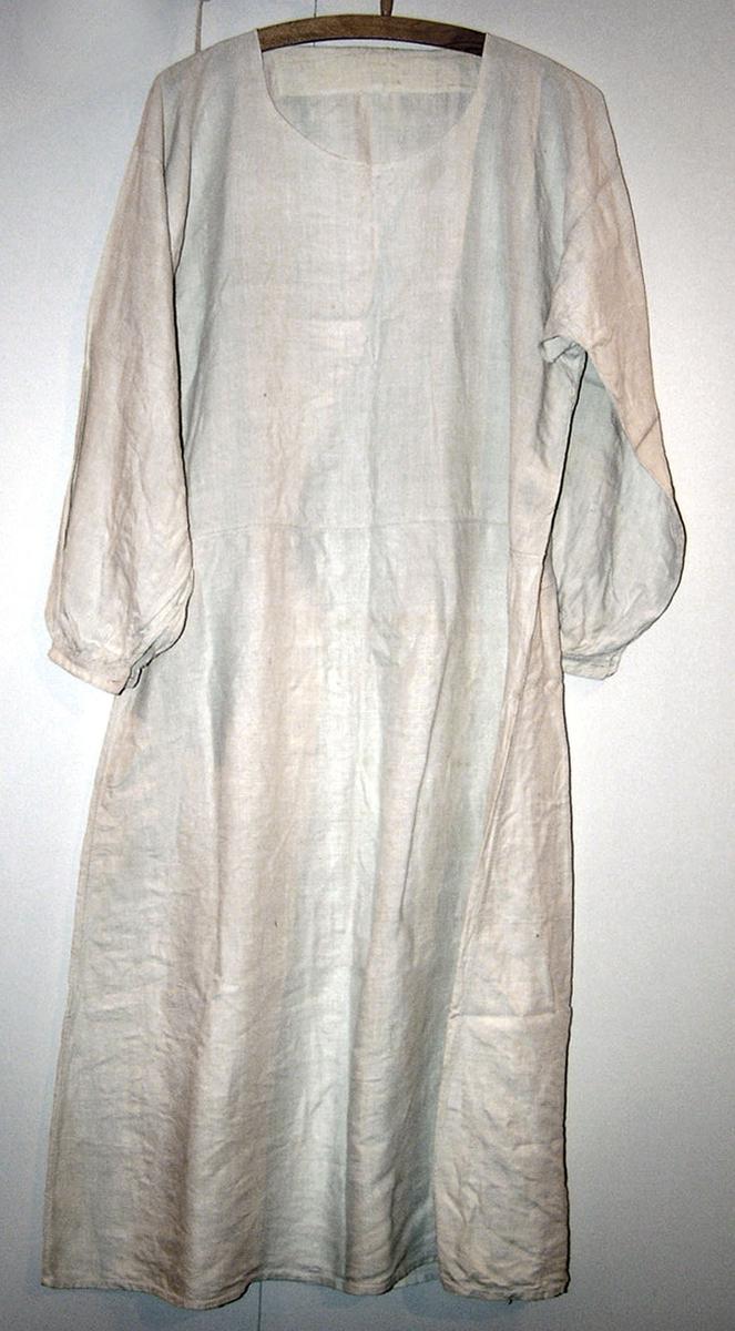 Form: Lang skjorte form, geometrisk form. Rund hals