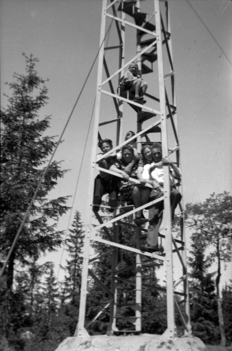 Mennesker på en mast