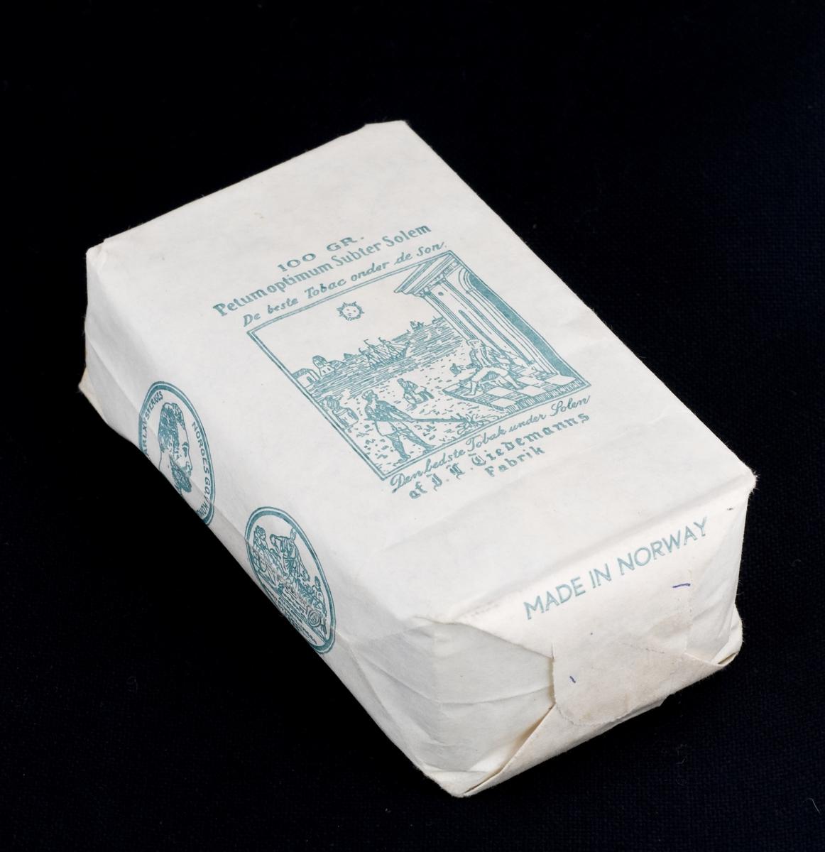 Tobakkspakning med innhold. 100 gr. pose med grønt trykk. Langpipetobakk.