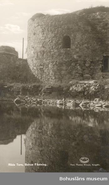 """Tryckt text på kortet: """"Röda Torn, Bohus Fästning""""."""