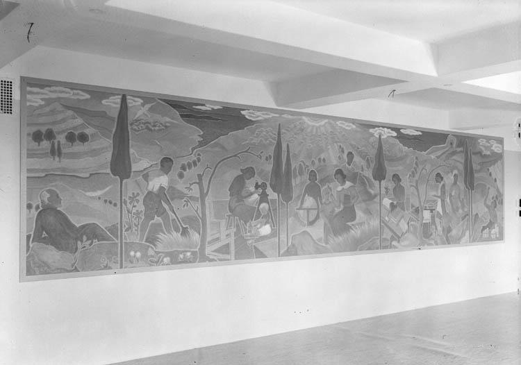 """Text till bilden:""""Tavla på väv. V.U. S. 17/6 1946. Motiv Jordbruk, Sömnad, Religion, matlagning och kemi""""."""