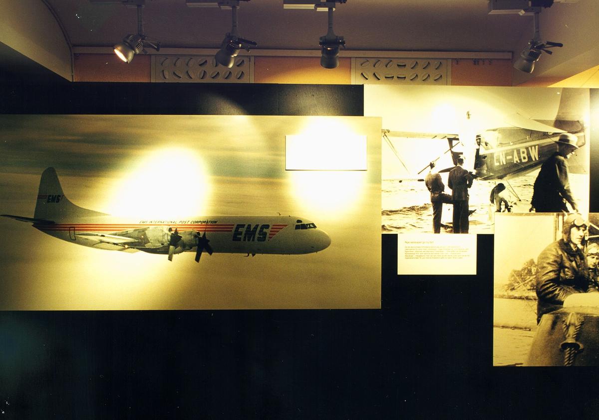 """Postmuseet, utstilling, """"Luftpost i Norge - fra ballong til jet"""", bilder av fly  med EMS på siden og luftpostsendinger."""